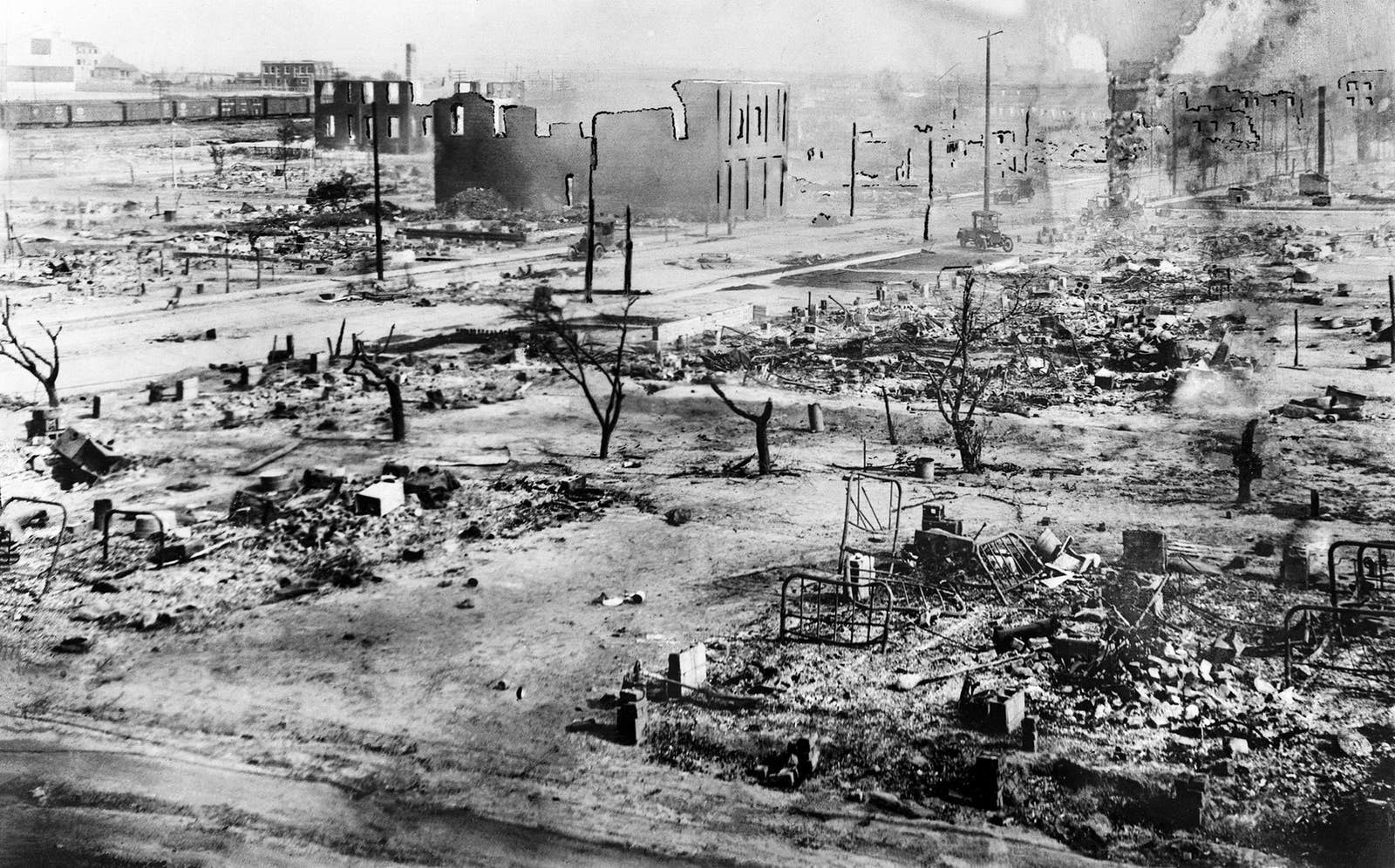 A scorched-earth scene of a town destroyed