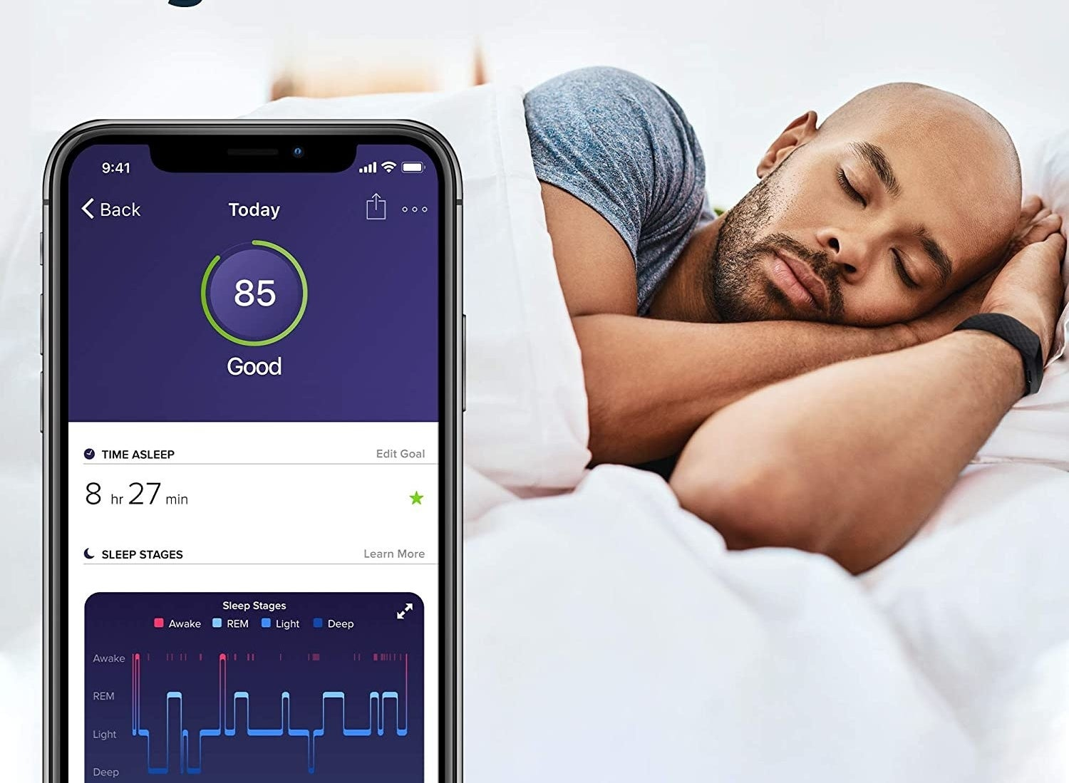 A person sleeping with the FitBit on and a phone tracking their patterns