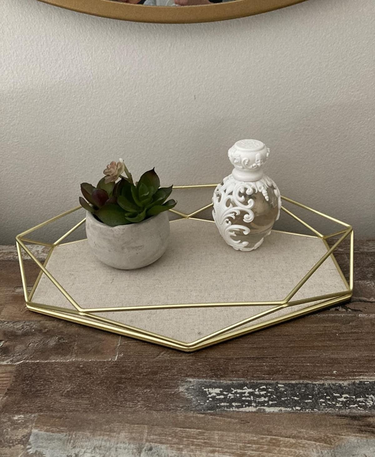 reviewer image of the umbra geometric tray on a customer's dresser
