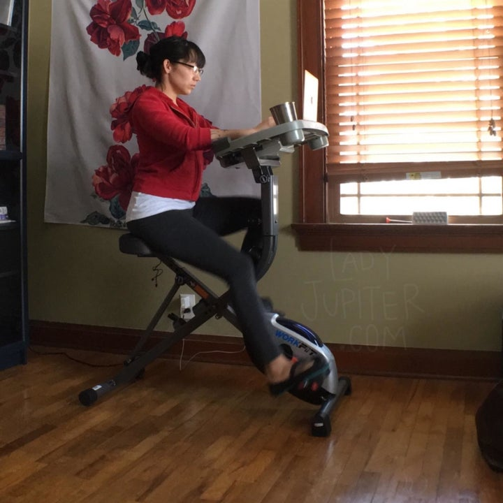 Reviewer sitting on desk bike