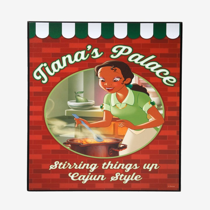 a wooden tiana's palace sign