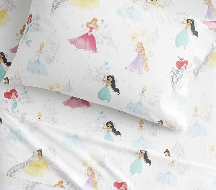 disney princess sheets with belle, jasmine, ariel, aurora, cinderella, and rapunzel on them