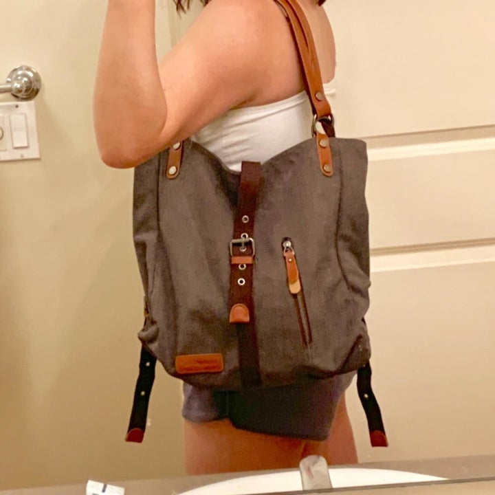 Reviewer holding carrier as a purse