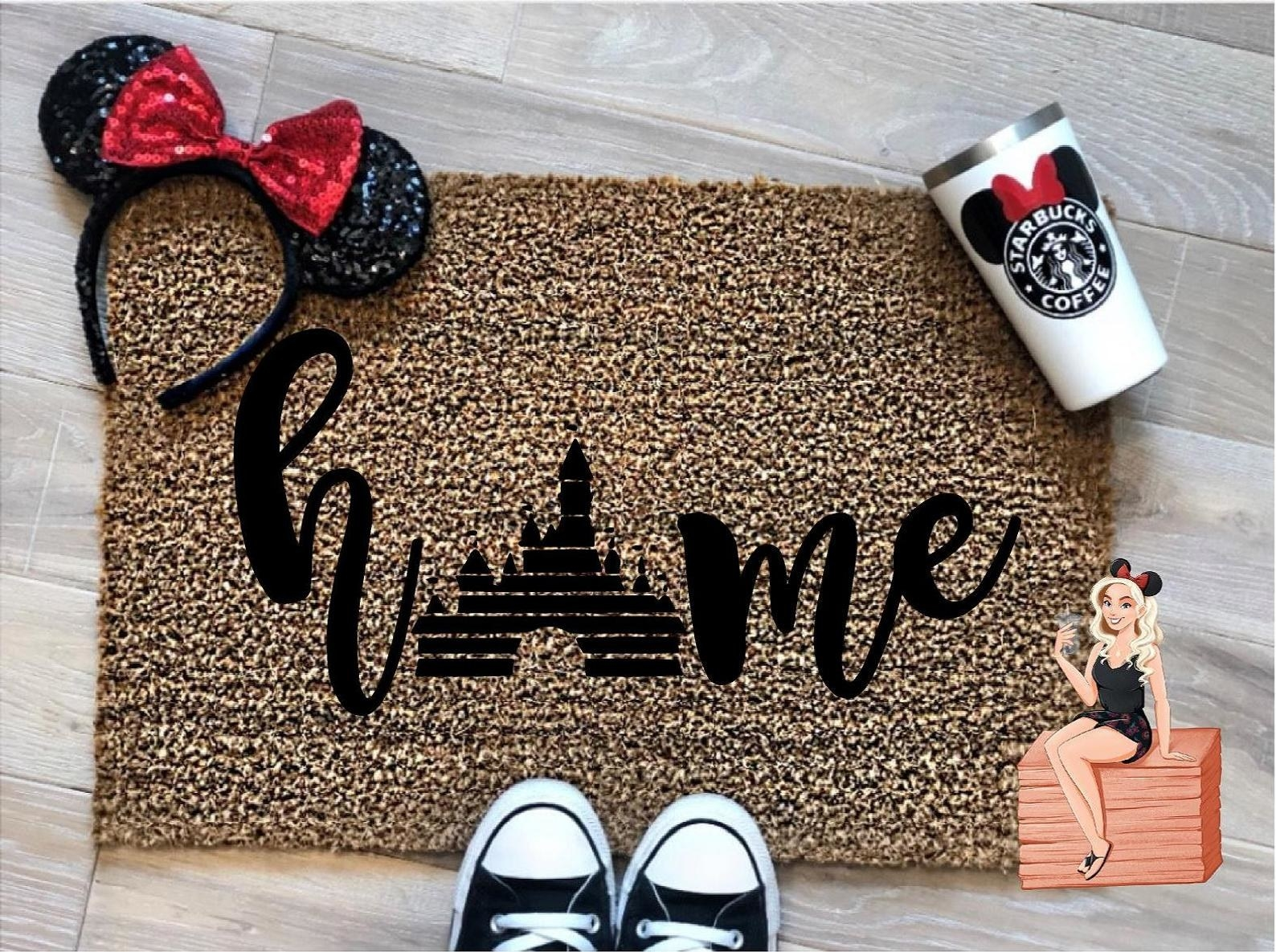 a doormat that says home on it with the disney castle as an O