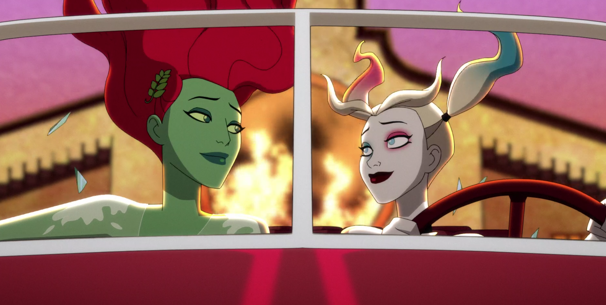 Poison Ivy and Harley looking at each other with an explosion in the background