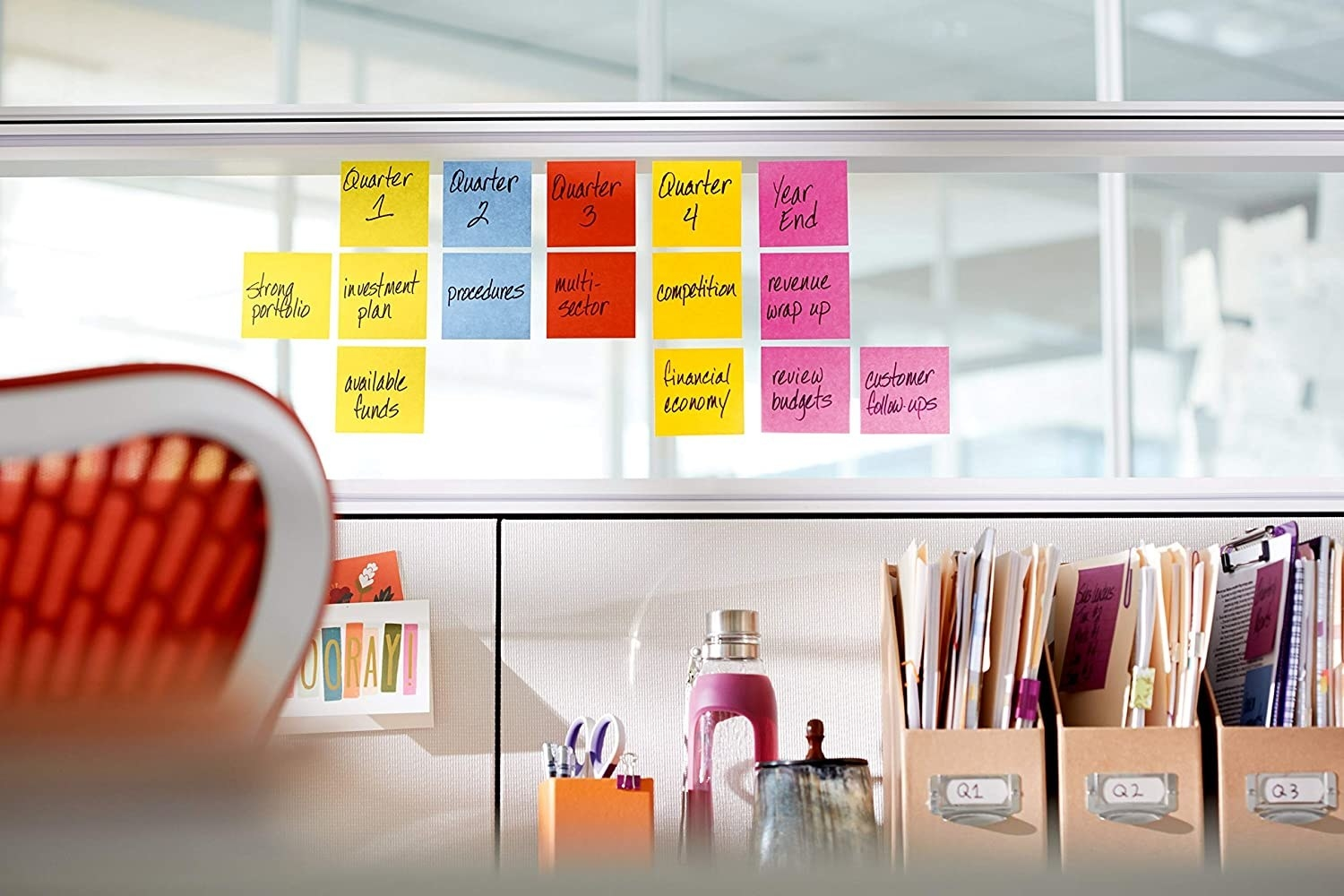 sticky notes on a window in an office