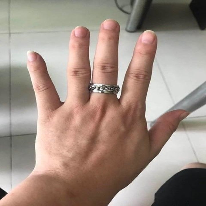 Reviewer showing ring on middle finger