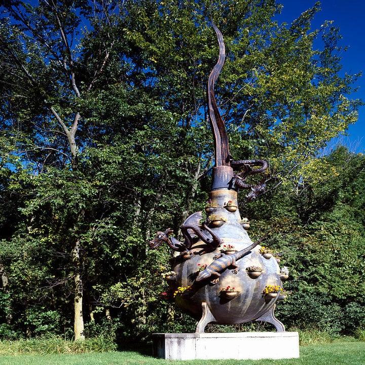 a strange metal statue in a garden
