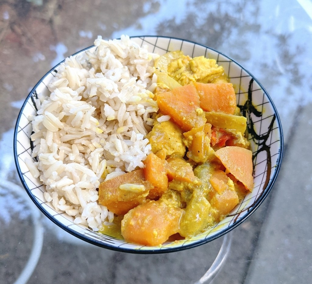 Bowl of rice and chicken curry with sweet potatoes