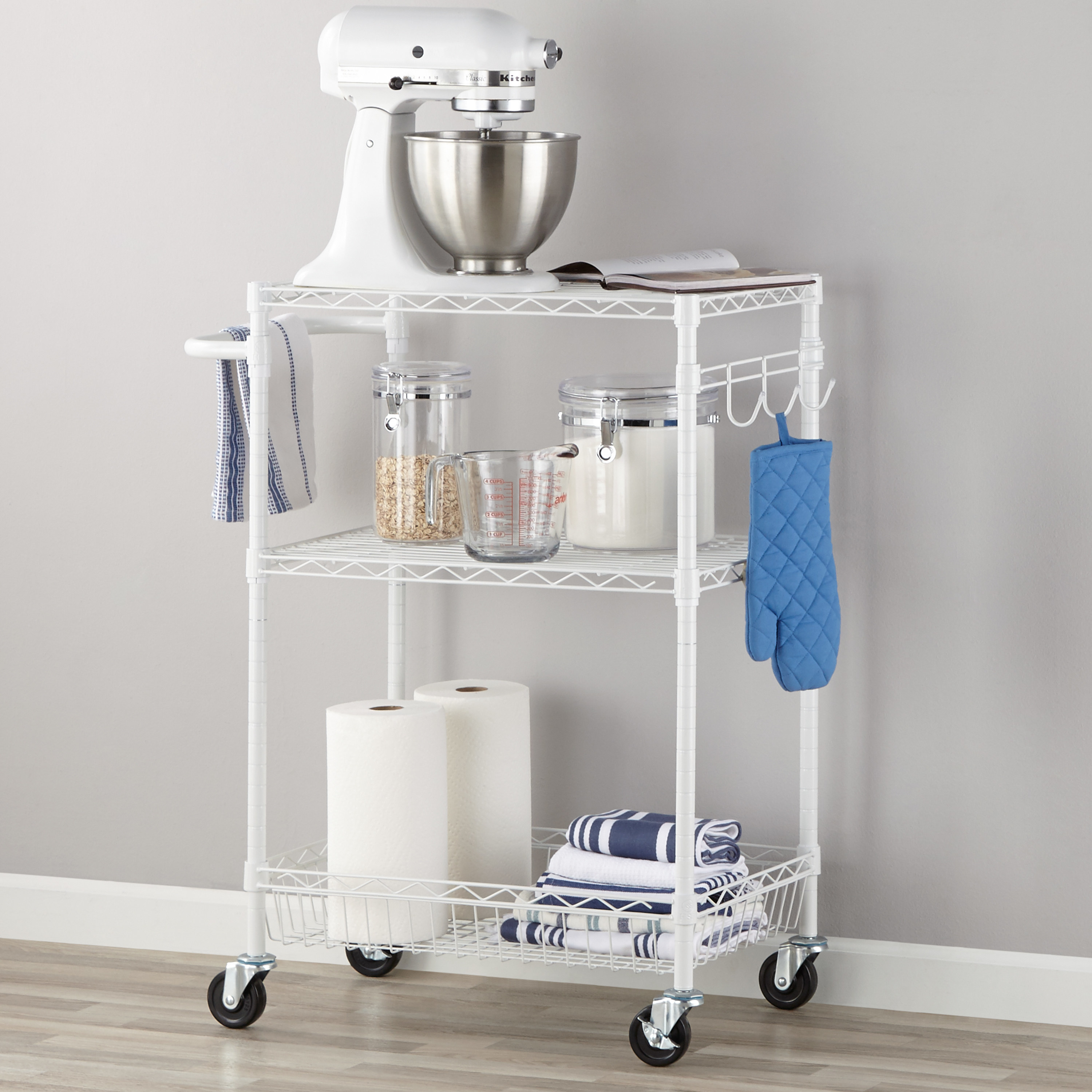 White rolling cart with kitchen supplies on the cart
