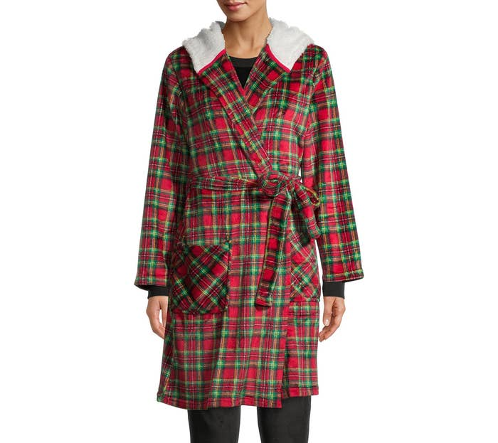 person wearing a tartan robe with faux sherpa lining and hood