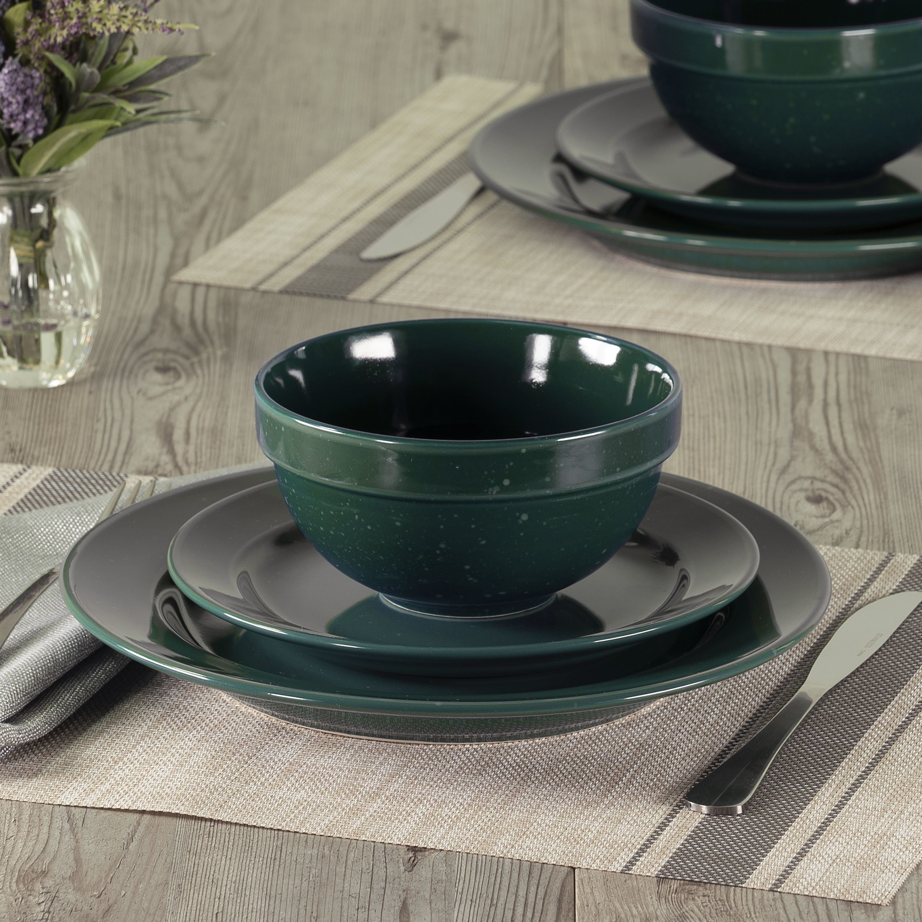 green speckled dinner set on a dining room table