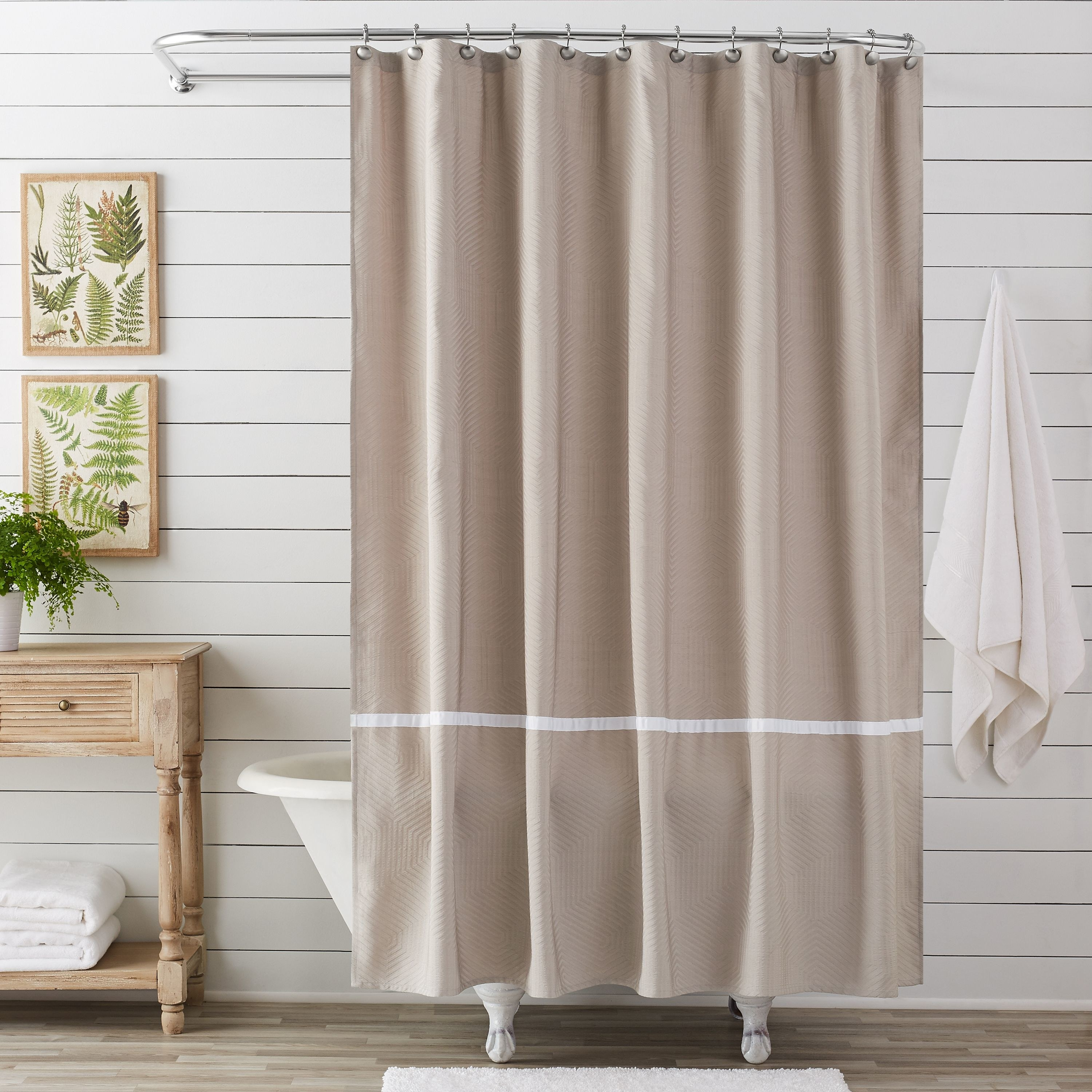 taupe shower curtain with a white stripe at the bottom