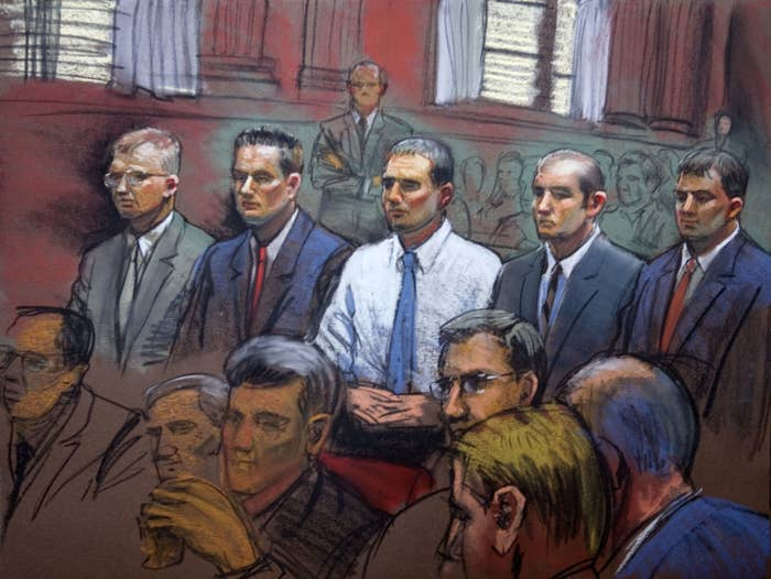 Five men appear in a courtroom illustration