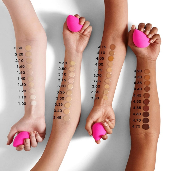 Models with different skin tones showing off all of the Beautyblender Liquid Whip Long Wear Foundation shades on their forearms
