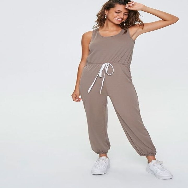 a model in the jumpsuit in beige