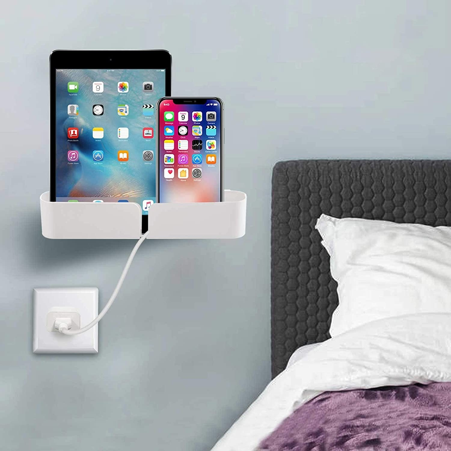 The bedside shelf holds a phone and a tablet and allows for charging