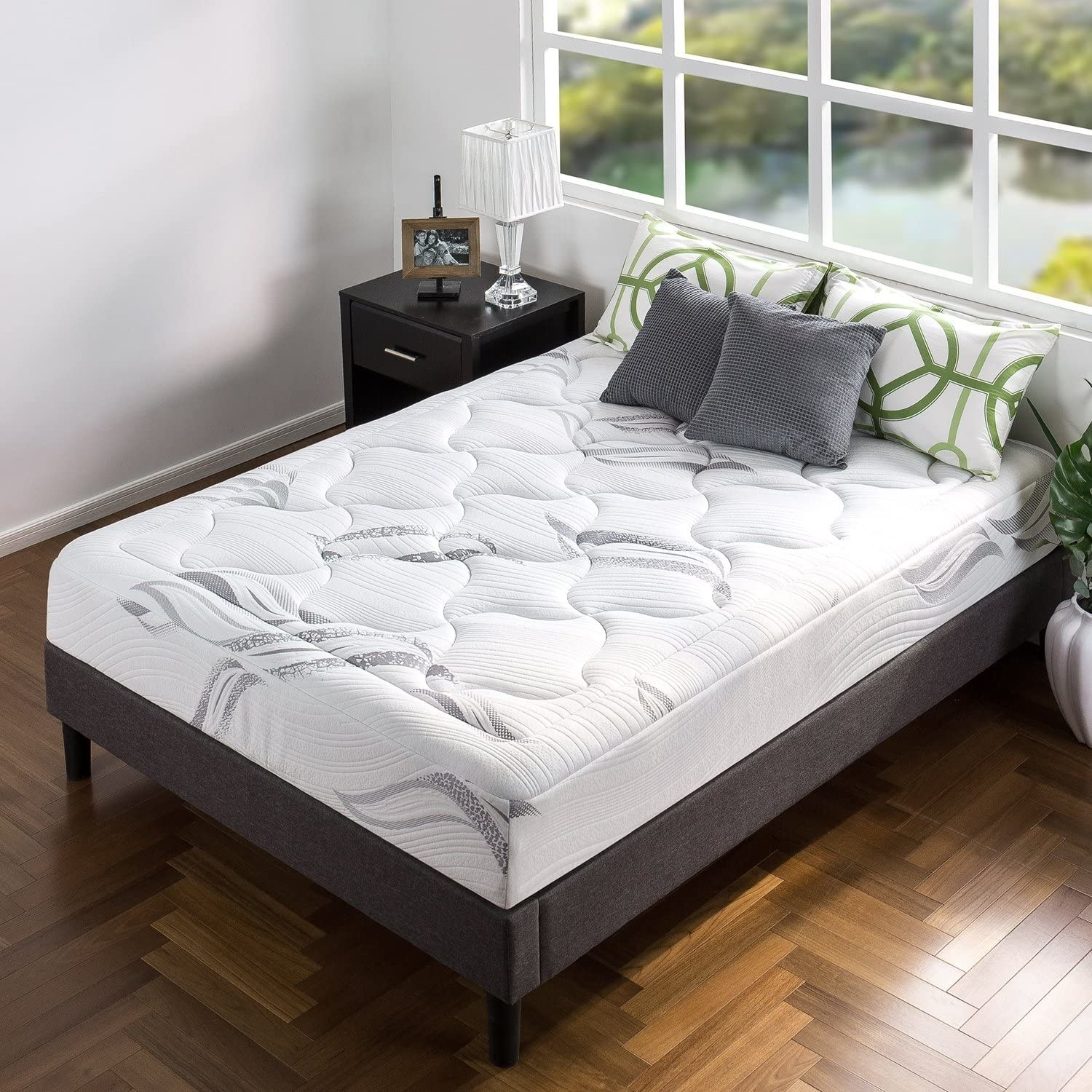 shot of a bed with the mattress on it with pillows but no other bedding