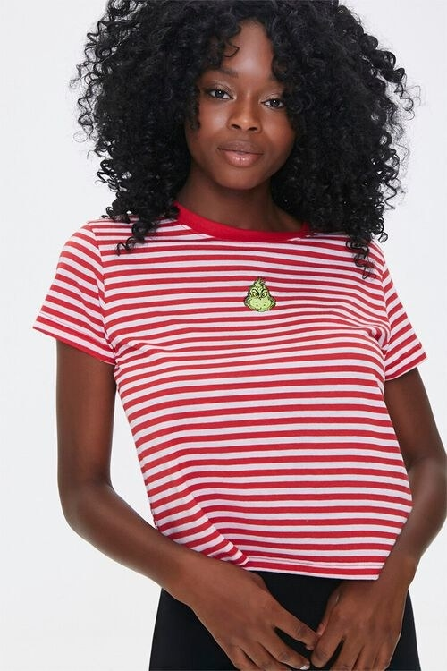 a model in the red and white striped tee with the grinch in the middle