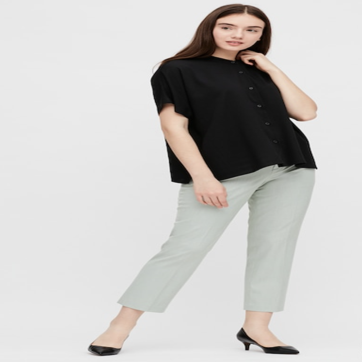 Front view of the same model wearing the blouse in black