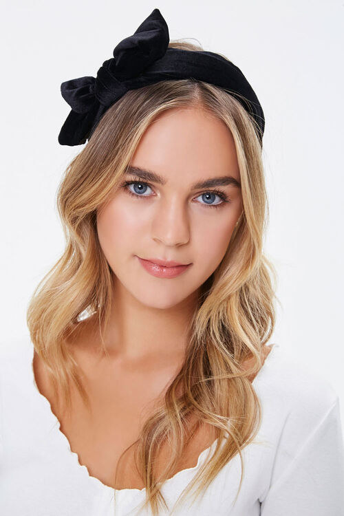 a model in the black bow headband