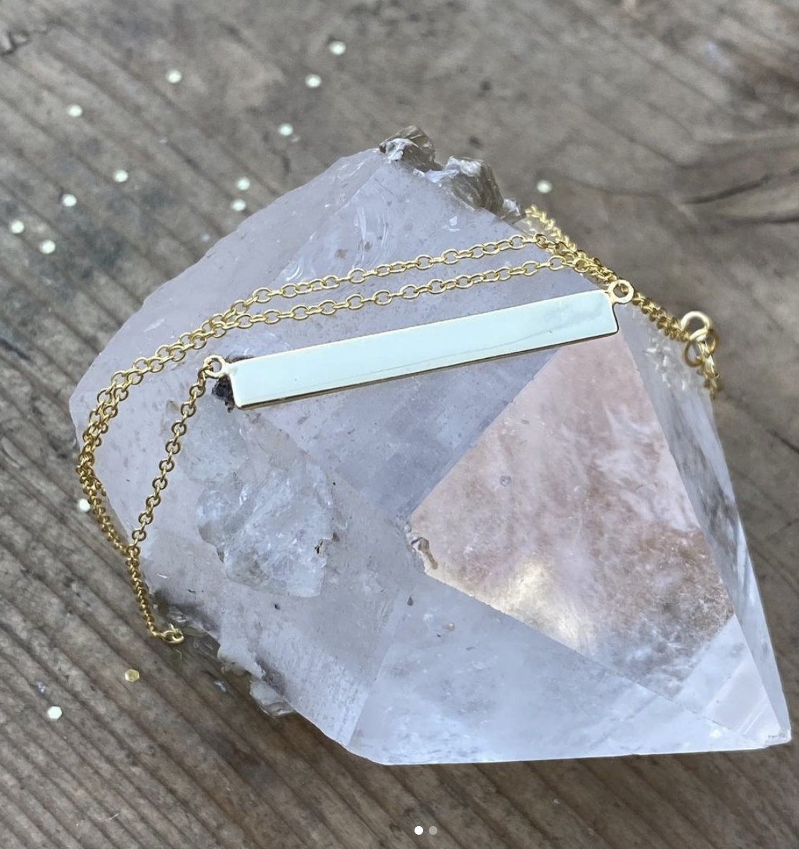 A plate necklace on a quartz stone
