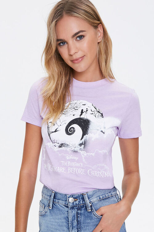 a model in a purple graphic tee with the nightmare logo on it and jack and sally