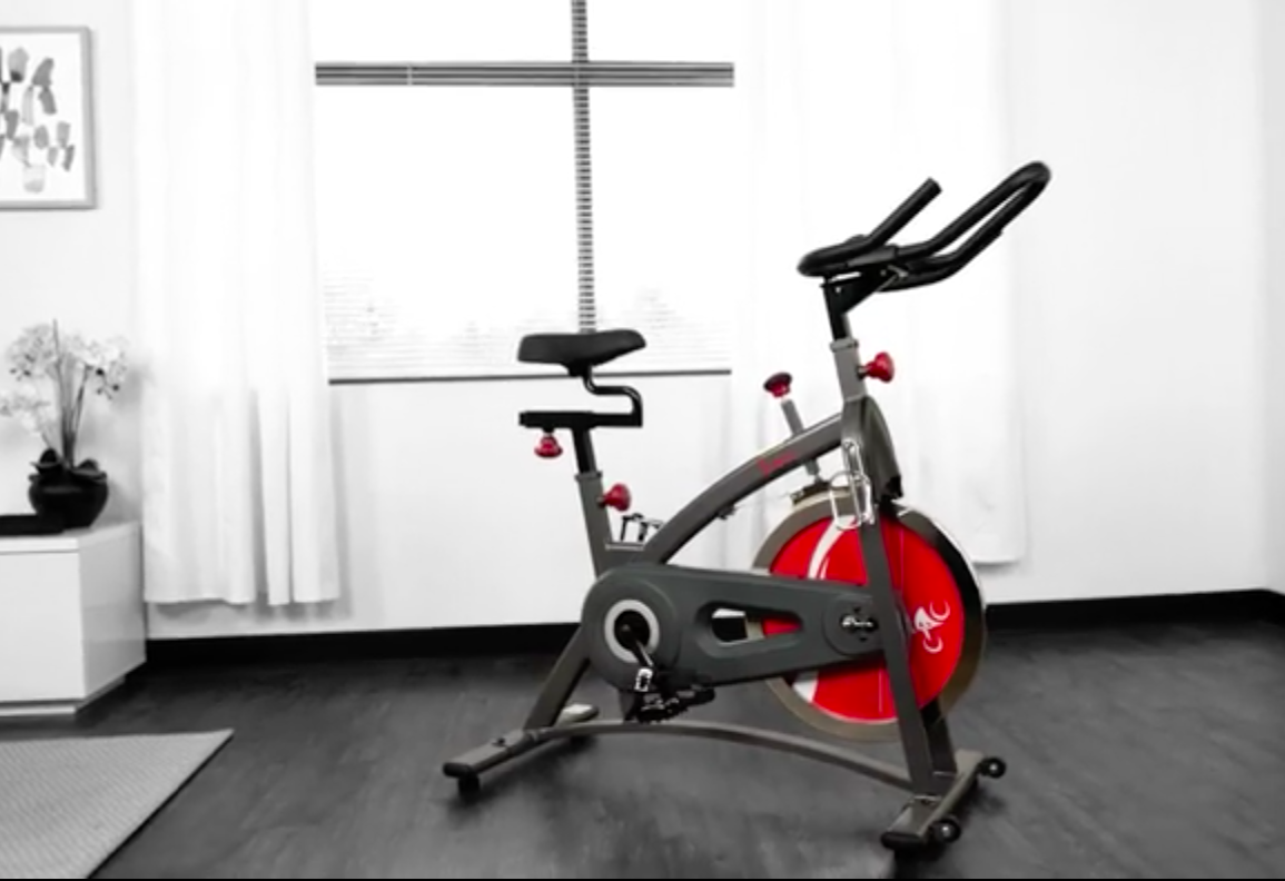 The indoor cycling bike in a bright room beside a big window