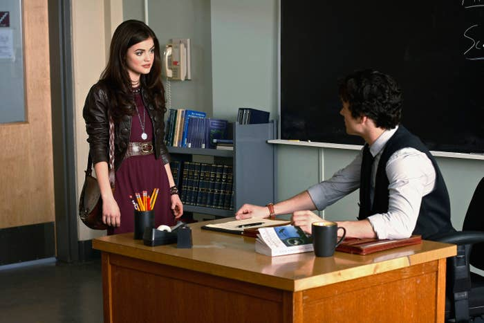 On Pretty Little Liars, Aria goes up to Ezra's desk