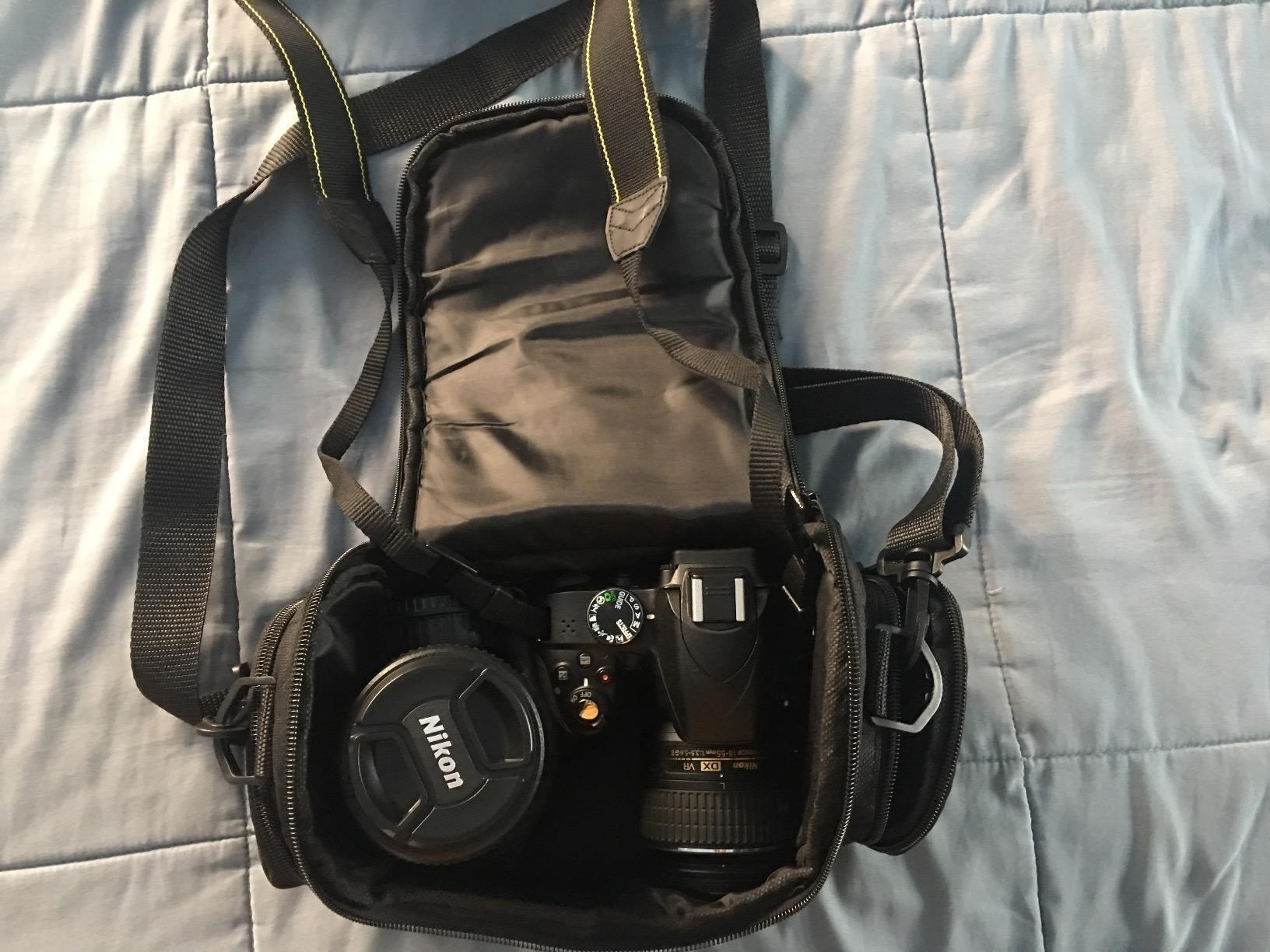 reviewer's camera bag with a camera and extra lens inside