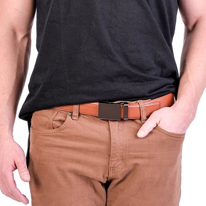 person wearing the belt with pants and a T-shirt