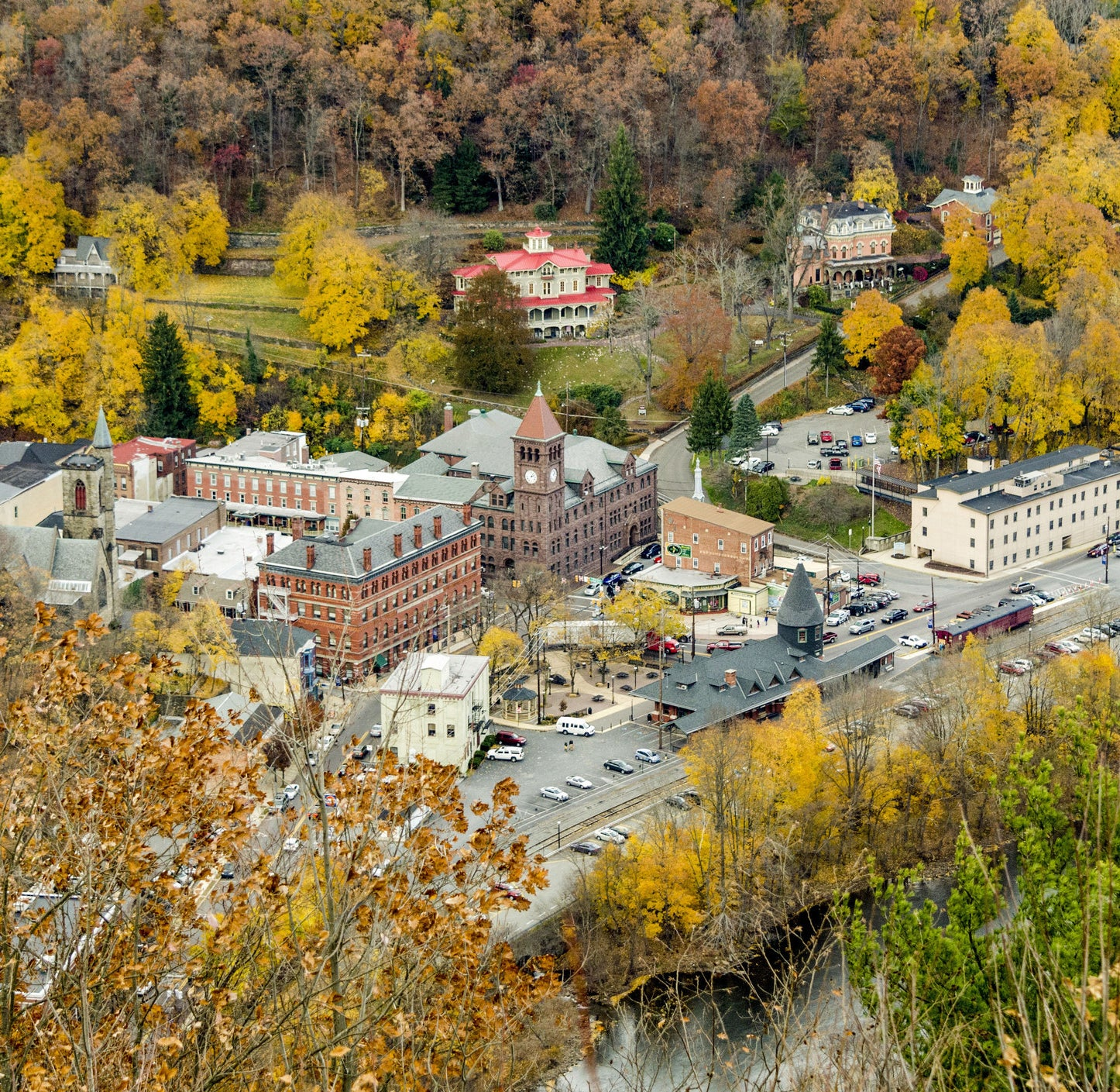 historic buildings and a townhall surrounded by fall foliage