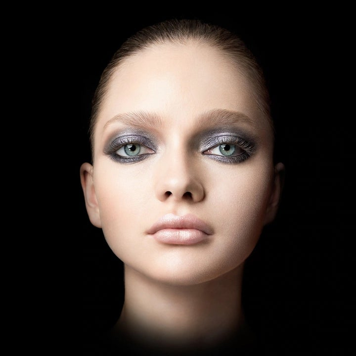 A model wearing the black and chrome eyeshadow duo