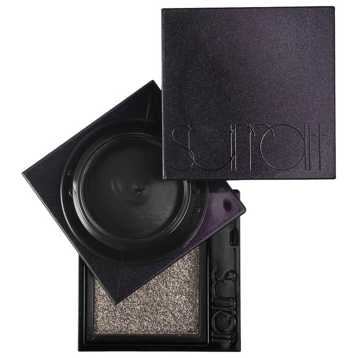 A black and chrome eyeshadow duo with matte cream in the middle
