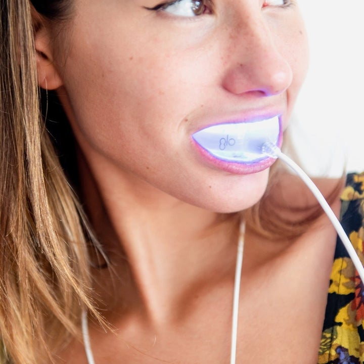A model using the GLO Heat and LED Light Whitening Mouthpiece