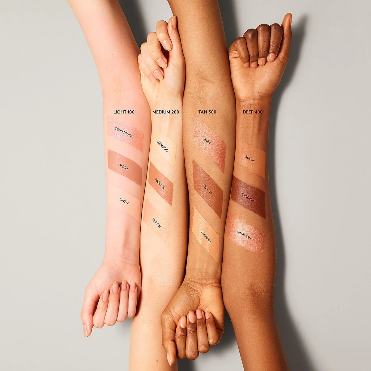 Models with different skin tones showing off all of the Match Stix shades on their forearms