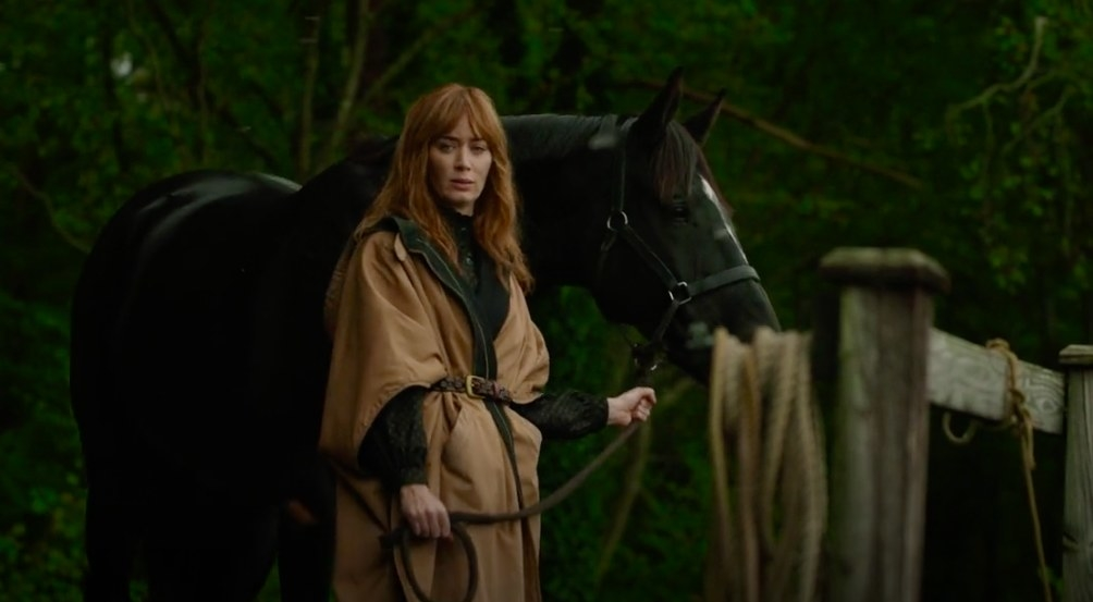Emily Blunt's character, Rosemary, standing next to her horse