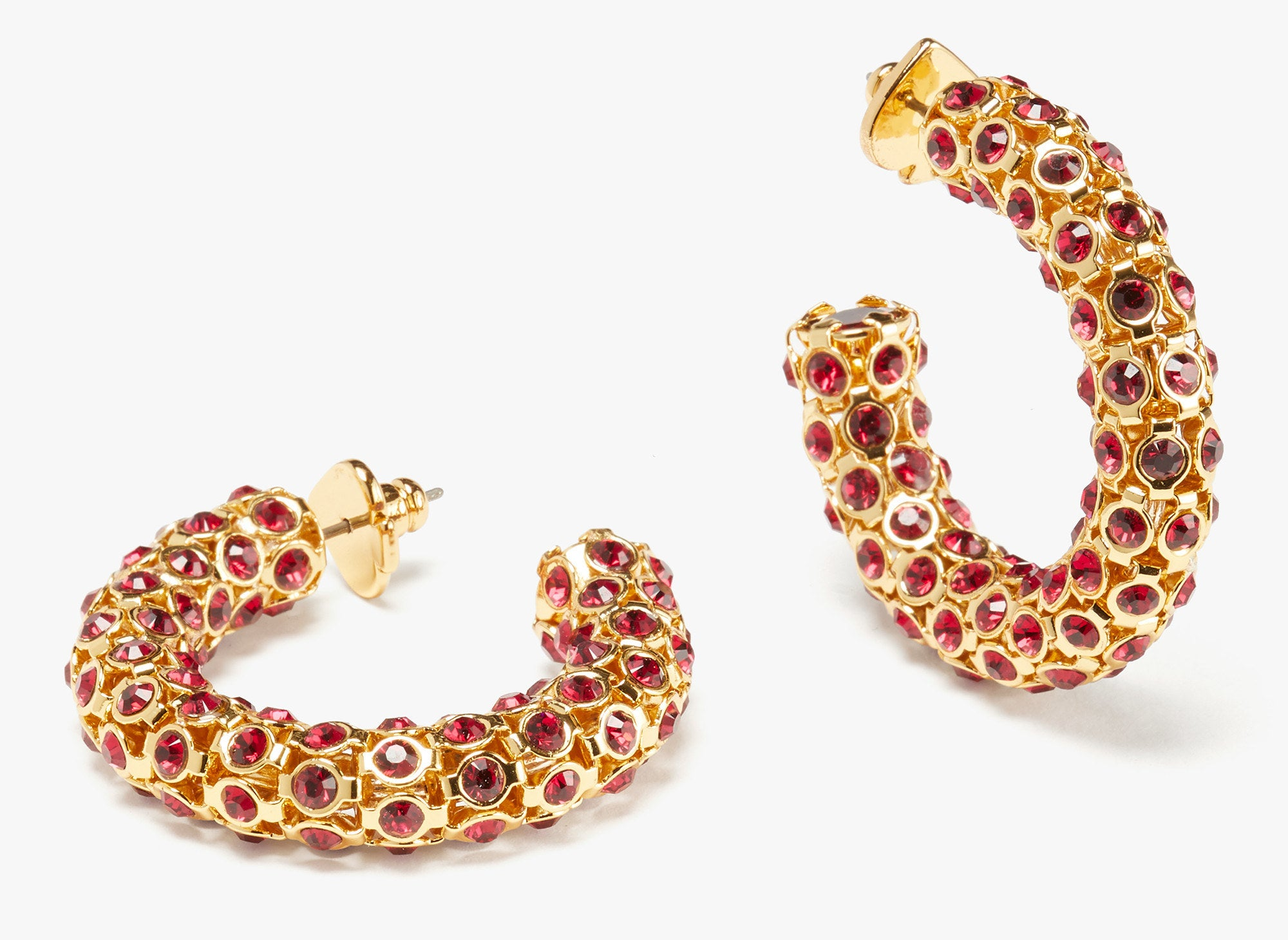 the earrings in gold with red ruby stones