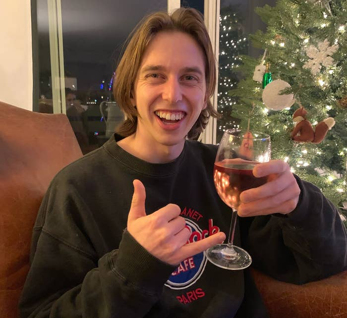 Stephen smiles with a glass of rosé