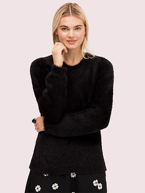 the model wearing the sweater in black