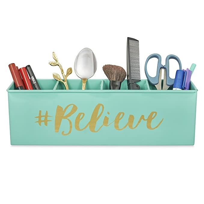 Teal organiser with the word '#Believe' printed on it in gold.