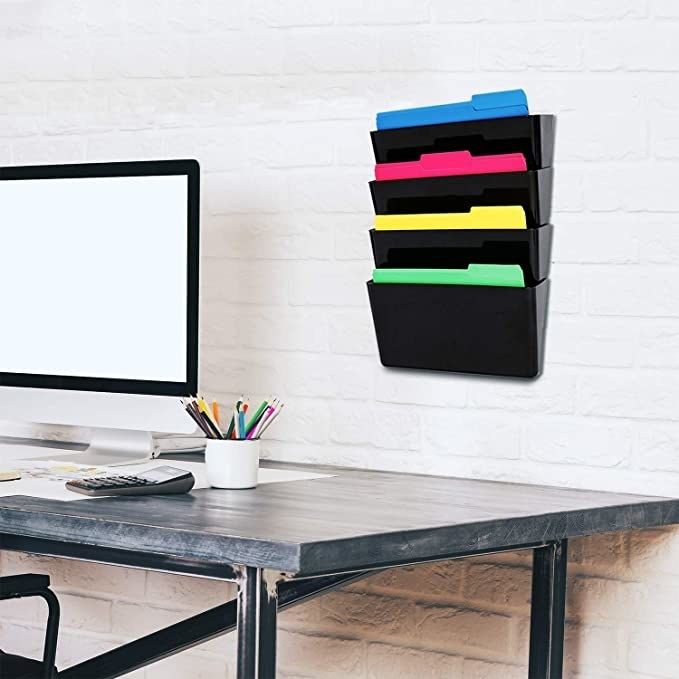 Black four tier hanging wall binder.
