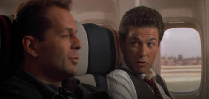 John McClane sits next to a man on an airplane