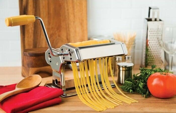 Pasta maker with fresh pasta inside