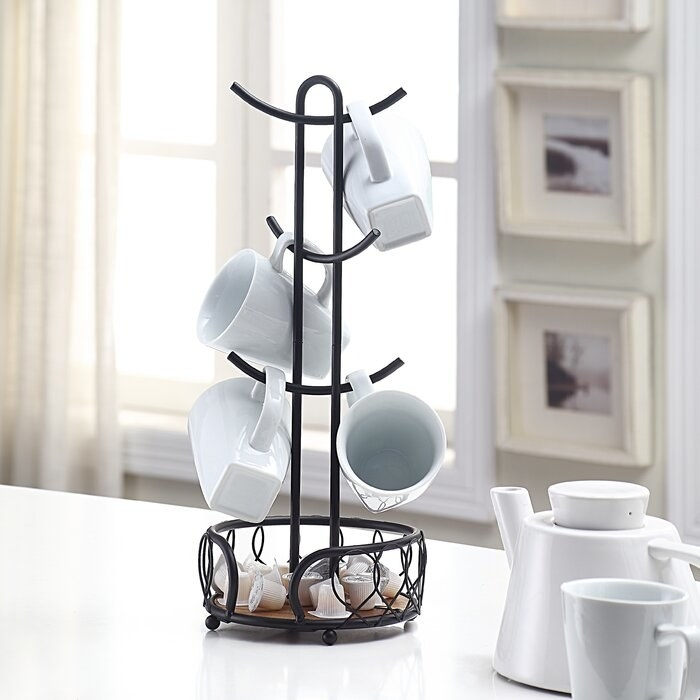 A mug tree holding a variety of white mugs