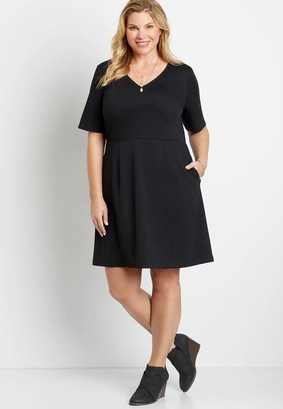 Model wearing the short sleeve black dress