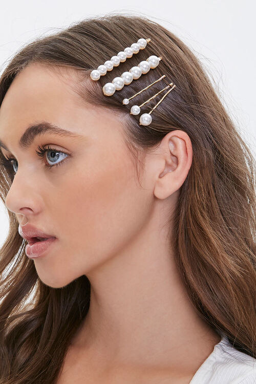 Model with five bobby pins in their hair with faux pearls on them