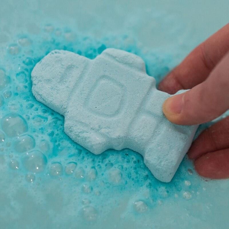 a robot shaped bath bomb bubbling away