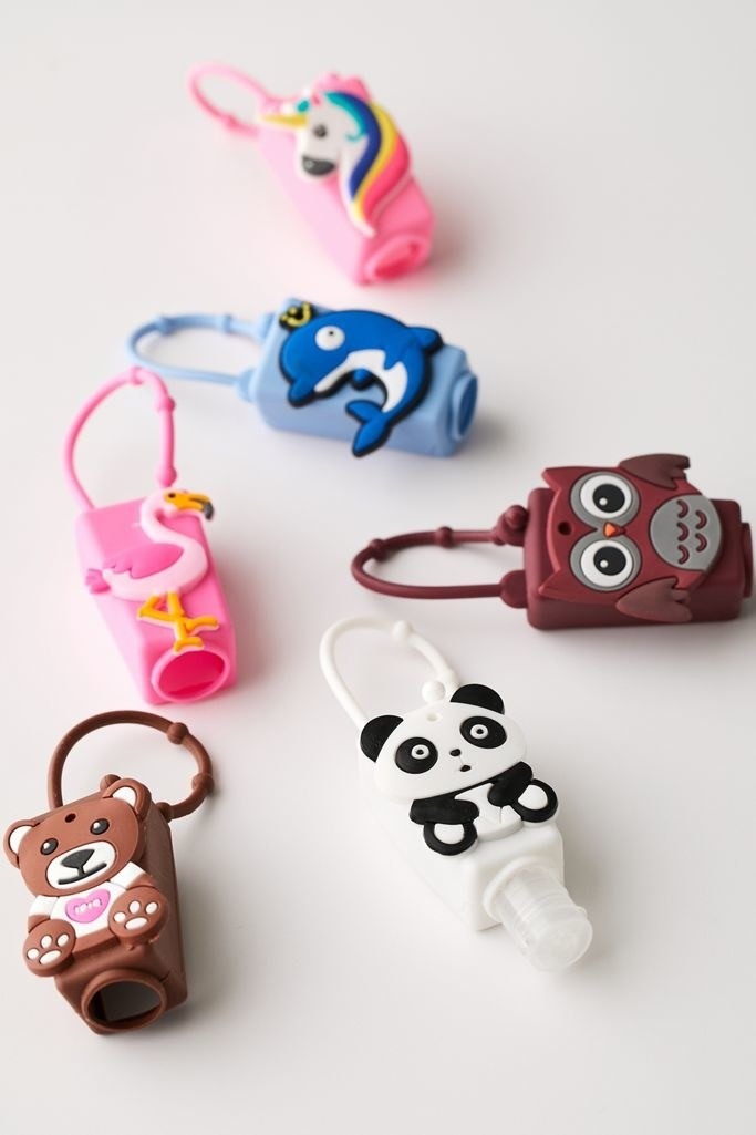 Mini hand sanitizers in animal shapes, including a bear, panda, owl, dolphin, flamingo, and unicorn