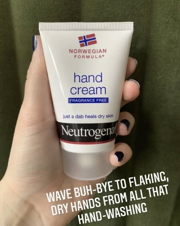 "BuzzFeed Editor Maitland Quitmeyer holding tube of hand cream with text that reads ""wave buh bye to flaking, dry hands from all that hand-washing"""